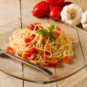 photo of delicious spaghetti with garlic and oil sauce on wooden table
